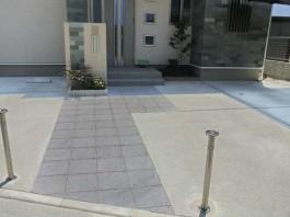 福岡県大牟田市の新築外構施工例。スタイリッシュな石でモダンなデザインアプローチ。